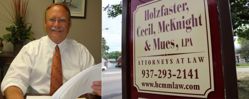 Holzfaster, Cecil, McKnight & Mues, LPA Dayton law firm sign with Robert L Mues, Esq.