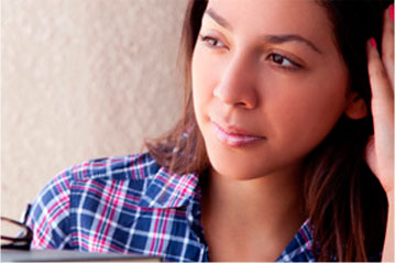 Young female with plaid shirt