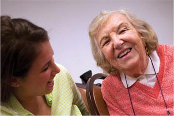 Elderly lady with caretaker
