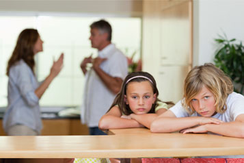 Upset girls with couple arguing in background