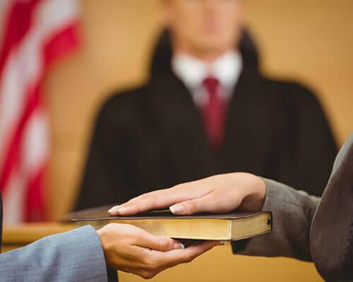 Dayton female in court being sworn in by judge